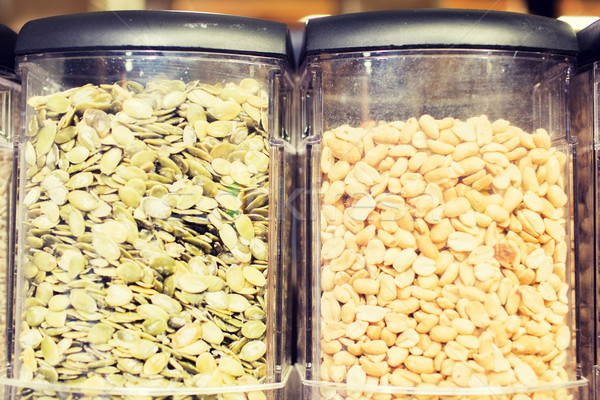 jars of peanuts and pumpkin seeds at grocery store Stock photo © dolgachov