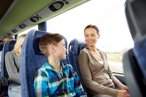happy family riding in travel bus Stock photo © dolgachov