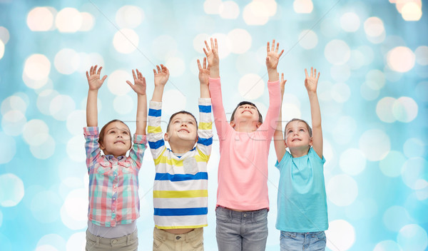 Boldog gyerekek felemelt kezek kék fények gyermekkor Stock fotó © dolgachov