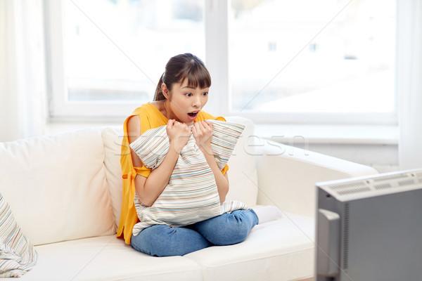 asian young woman watching tv at home Stock photo © dolgachov