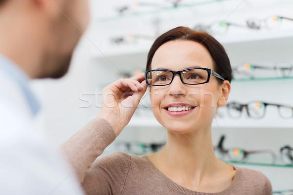 женщину очки оптика магазине Сток-фото © dolgachov