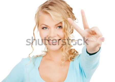 happy woman in white t-shirt showing ok hand sign Stock photo © dolgachov