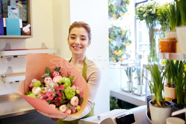 Sonriendo florista mujer personas Foto stock © dolgachov
