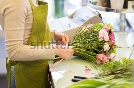 close up of woman with flowers and scissors Stock photo © dolgachov