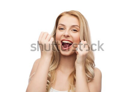 happy young woman with dental floss cleaning teeth Stock photo © dolgachov