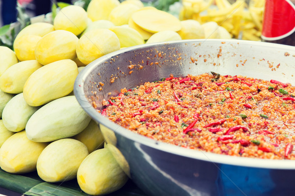 chilly wok or pilaf and mango at street market Stock photo © dolgachov