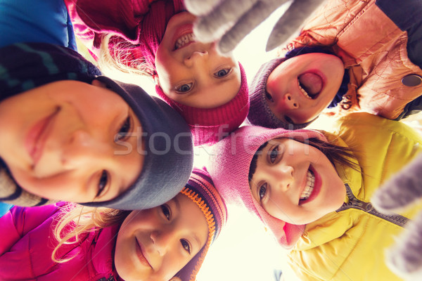 group of happy children faces in circle Stock photo © dolgachov