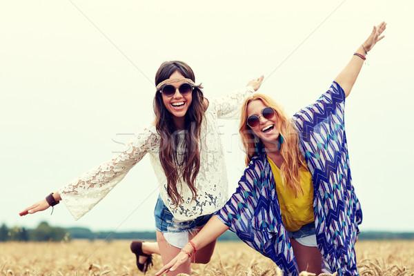 happy hippie women having fun on cereal field Stock photo © dolgachov