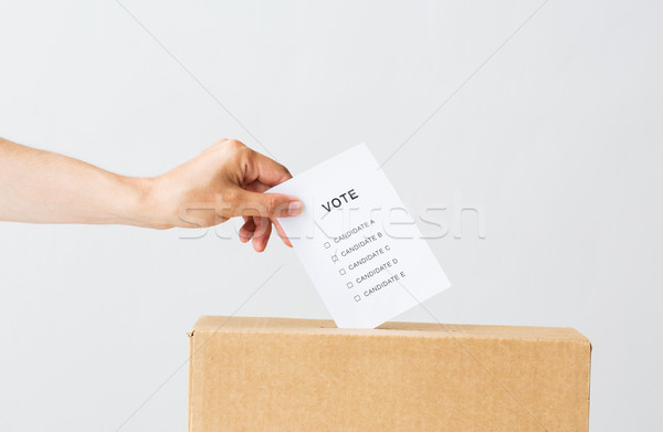 man putting his vote into ballot box on election Stock photo © dolgachov