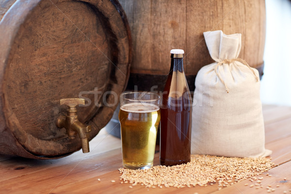 close up of beer barrel, glass, bottle and malt Stock photo © dolgachov