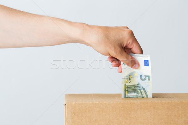 Uomo euro soldi donazione finestra carità Foto d'archivio © dolgachov