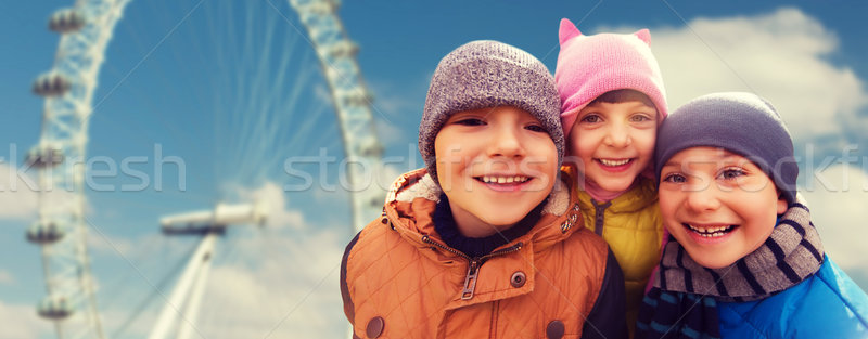 happy little children faces over ferry wheel Stock photo © dolgachov