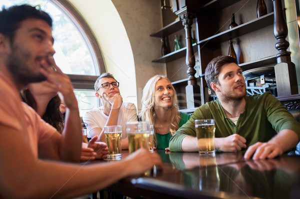 Amigos cerveza viendo fútbol bar pub Foto stock © dolgachov