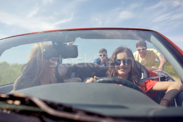 happy friends pushing broken cabriolet car Stock photo © dolgachov