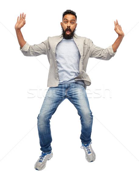 indian young man jumping in air Stock photo © dolgachov