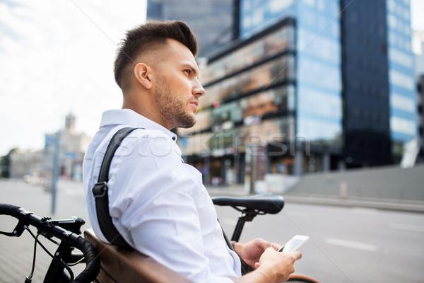 男 スマートフォン 自転車 市 人 技術 ストックフォト © dolgachov