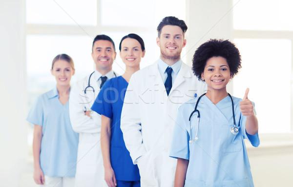 Grupo feliz médicos hospital profesión personas Foto stock © dolgachov