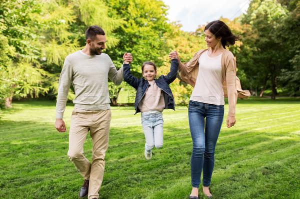 happy family walking in summer park and having fun Stock photo © dolgachov
