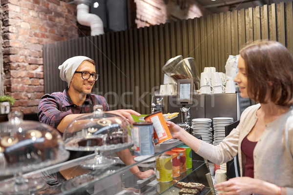 happy woman buying chai latte drink at vegan cafe Stock photo © dolgachov