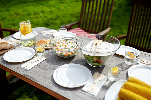 table with food for dinner at summer garden party Stock photo © dolgachov