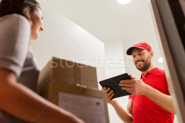 deliveryman with tablet pc and customer with boxes Stock photo © dolgachov