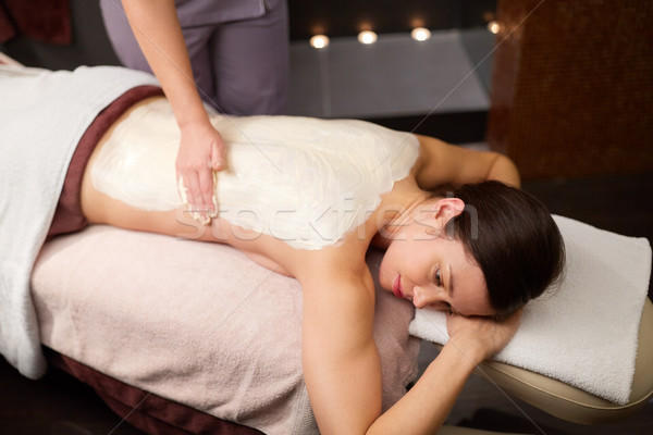 woman lying and having back massage at spa Stock photo © dolgachov
