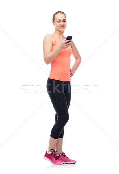 happy smiling sportive young woman with smartphone Stock photo © dolgachov