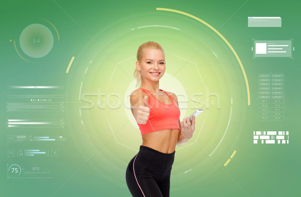 Stock photo: smiling sporty woman with smartphone