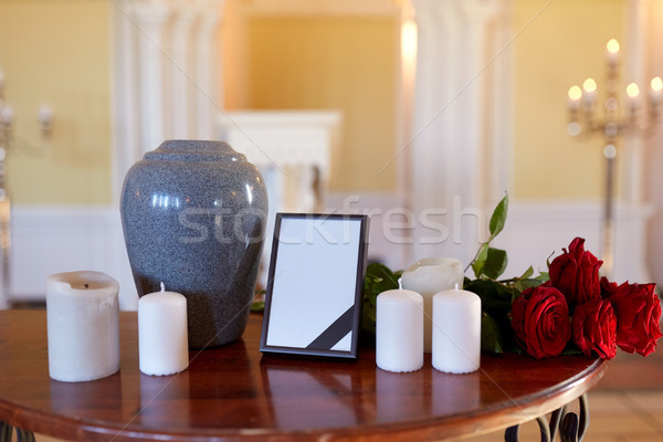 photo frame, cremation urn and candles in church Stock photo © dolgachov