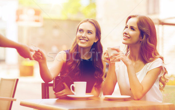 women with credit card paying for coffee at cafe Stock photo © dolgachov