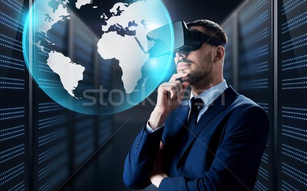 businessman in virtual reality headset with globe Stock photo © dolgachov