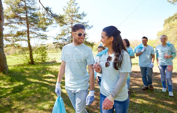volunteers with garbage bags talking outdoors Stock photo © dolgachov