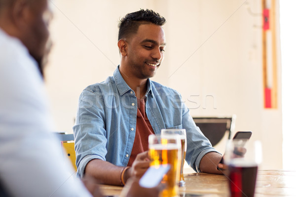 happy male friends drinking beer at bar or pub Stock photo © dolgachov