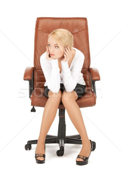 Giovani imprenditrice seduta sedia foto donna Foto d'archivio © dolgachov