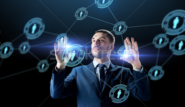 businessman with virtual network contacts Stock photo © dolgachov