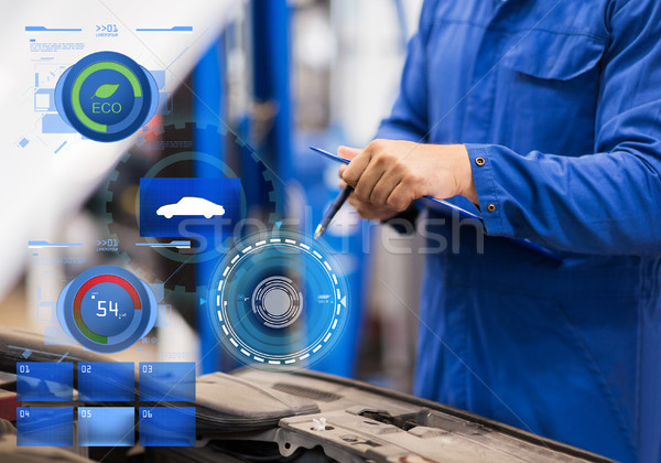 auto mechanic man with clipboard at car workshop Stock photo © dolgachov