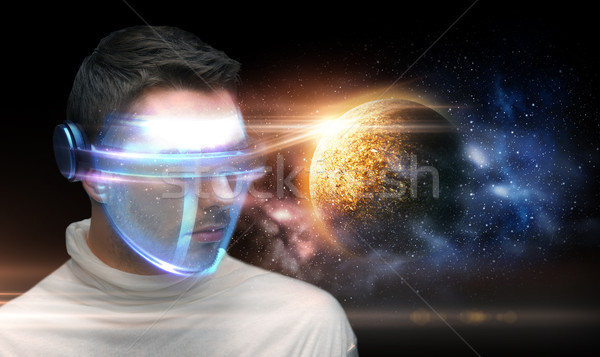 man in 3d glasses over planet and space Stock photo © dolgachov