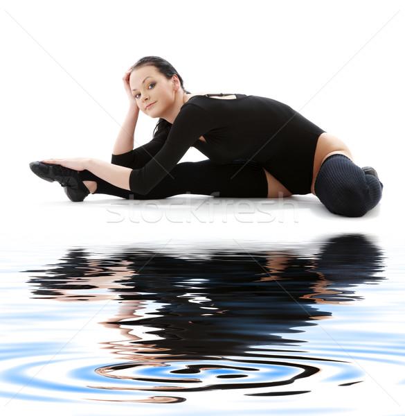 fitness in black leotard on white sand #5 Stock photo © dolgachov