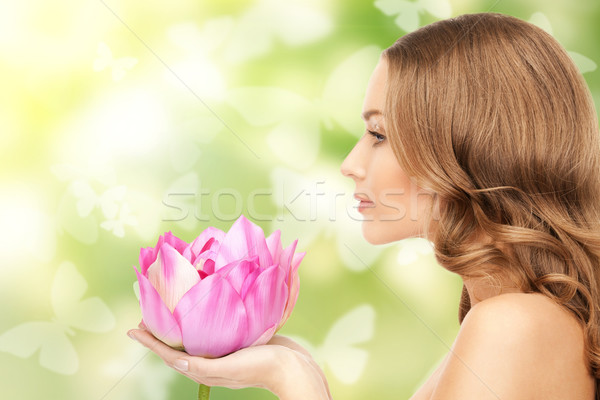 beautiful woman with lotus flower and butterflies Stock photo © dolgachov