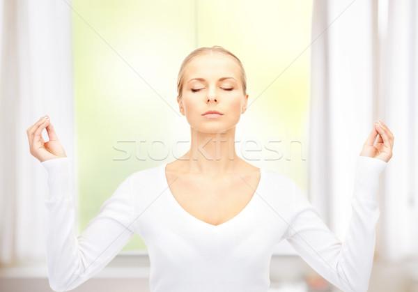 beautiful woman in meditation Stock photo © dolgachov