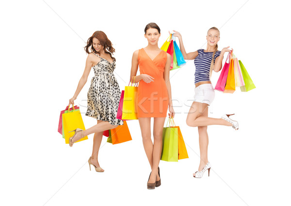 attractive girls holding color shopping bags Stock photo © dolgachov