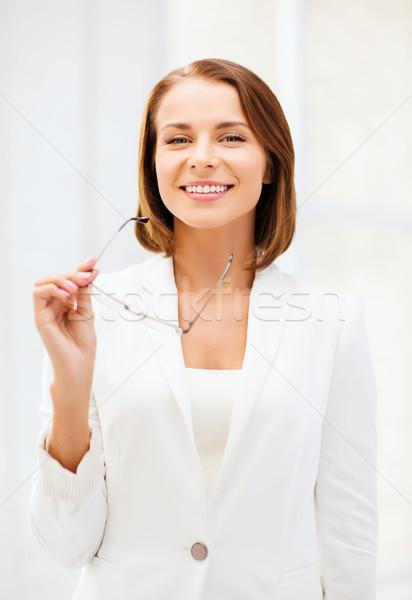businesswoman with eyeglasses Stock photo © dolgachov