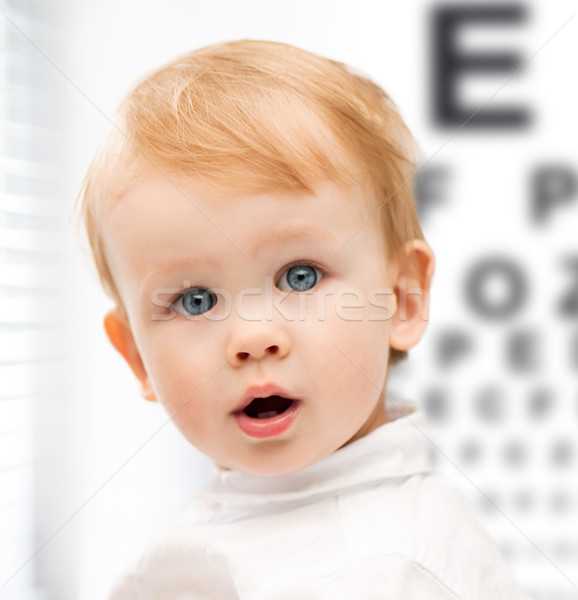 adorable baby child with eyesight testing board Stock photo © dolgachov