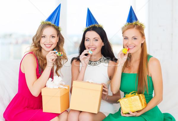 üç kadın hediyeler Stok fotoğraf © dolgachov