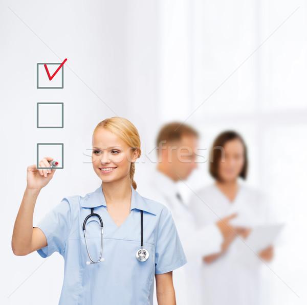 Doktor hemşire çizim onay kutusunu sağlık tıbbi Stok fotoğraf © dolgachov