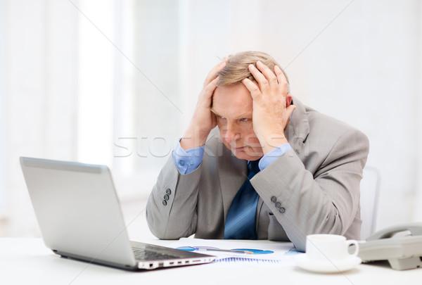 Zaklatott idősebb üzletember laptop telefon üzlet Stock fotó © dolgachov