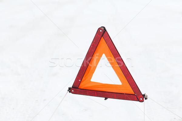closeup of warning triangle on snow Stock photo © dolgachov
