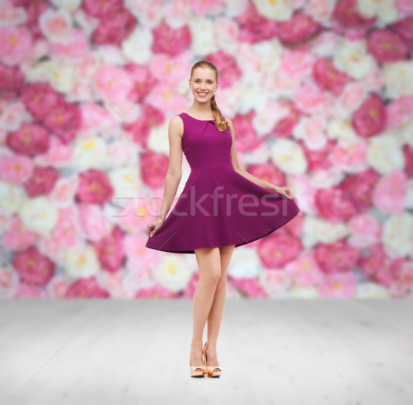 young woman in purple dress and high heels Stock photo © dolgachov
