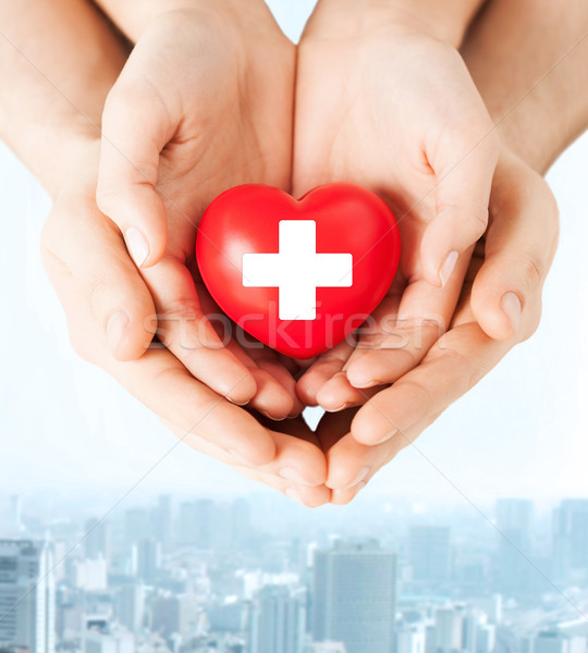 male and female hands with red heart Stock photo © dolgachov