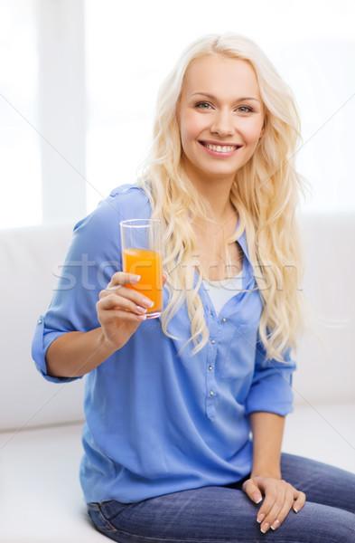 Stockfoto: Glimlachende · vrouw · glas · sinaasappelsap · home · gezondheidszorg · voedsel